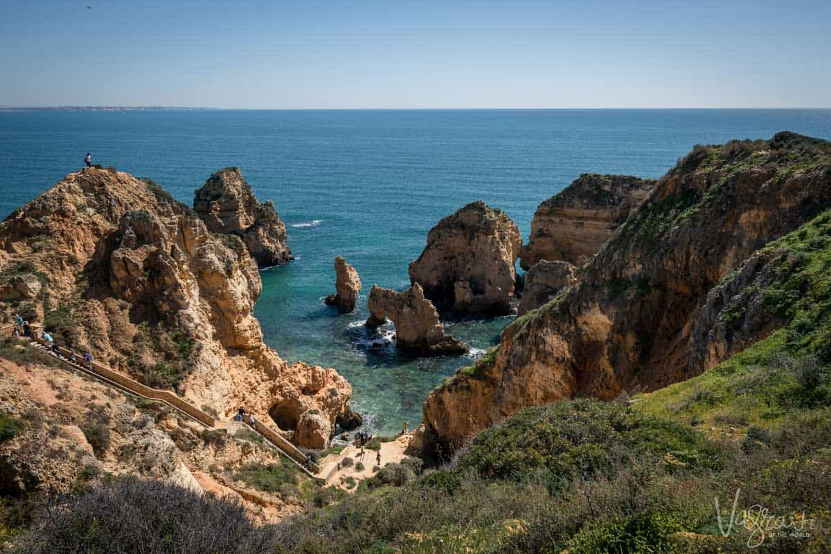 The yellow cliffs and sea caves of Lagos in the Algarve in Portugal.