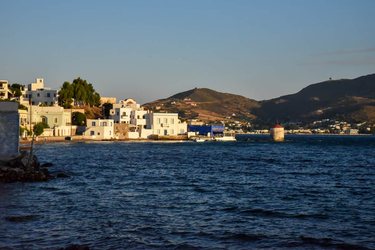 Views across the water to Leros Island village at sunset.