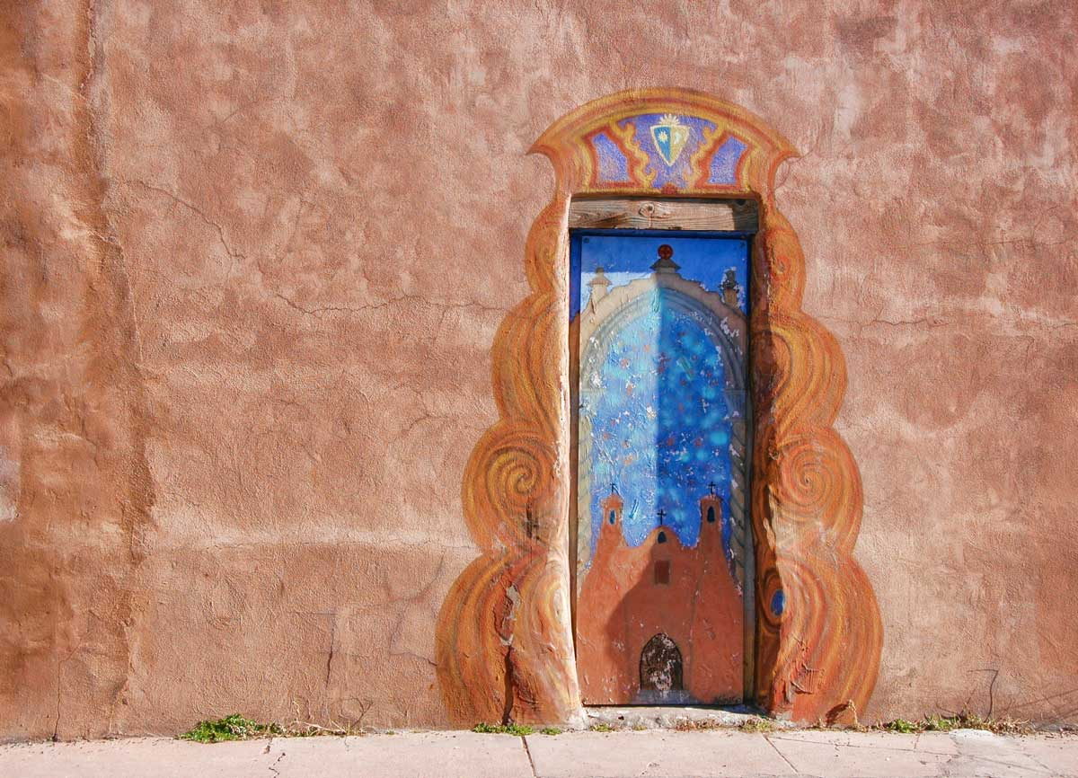 Painted door in a typical Santa Fe historic building in New Mexico.