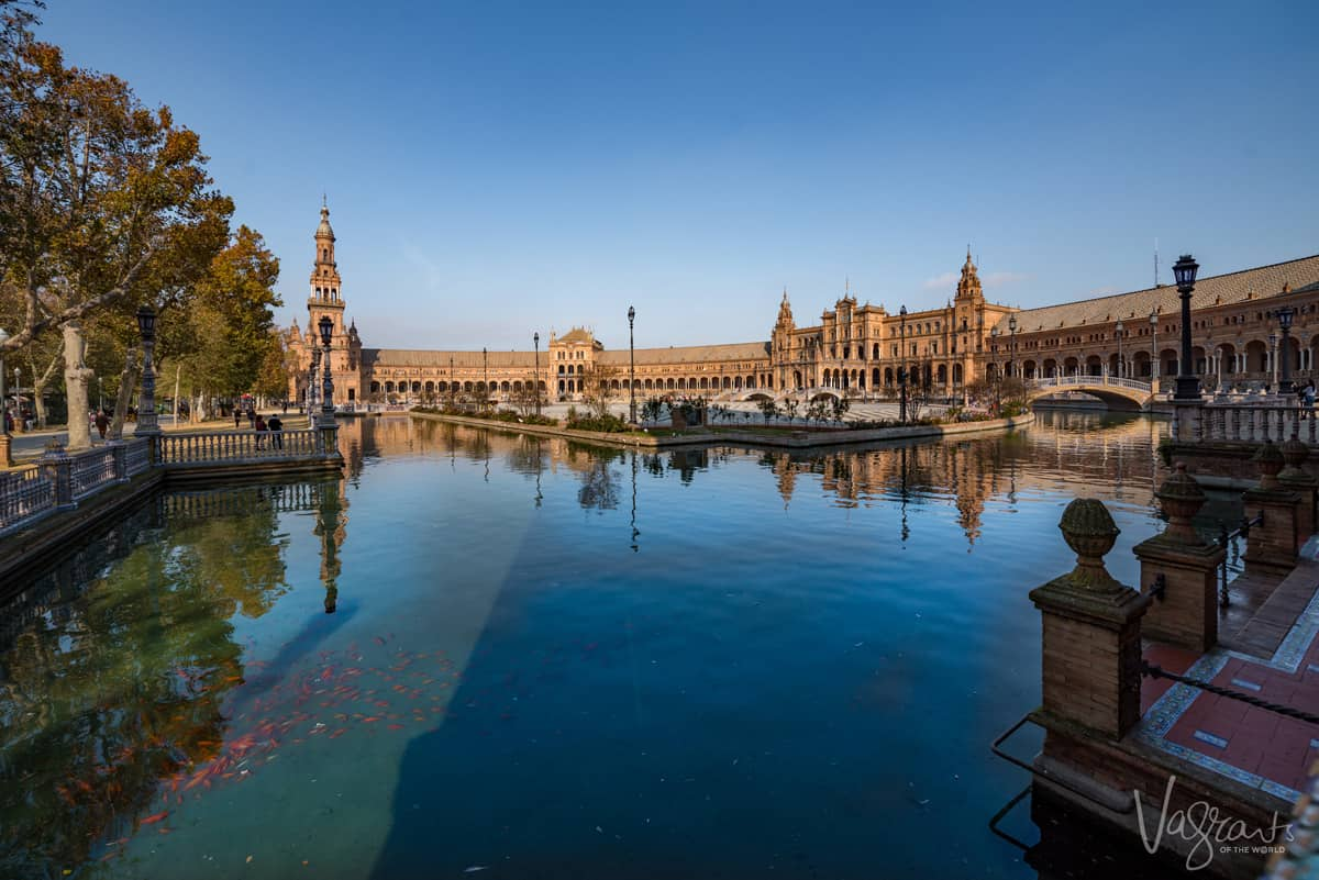Looking accross the water in Plaza Espana in Seville.
