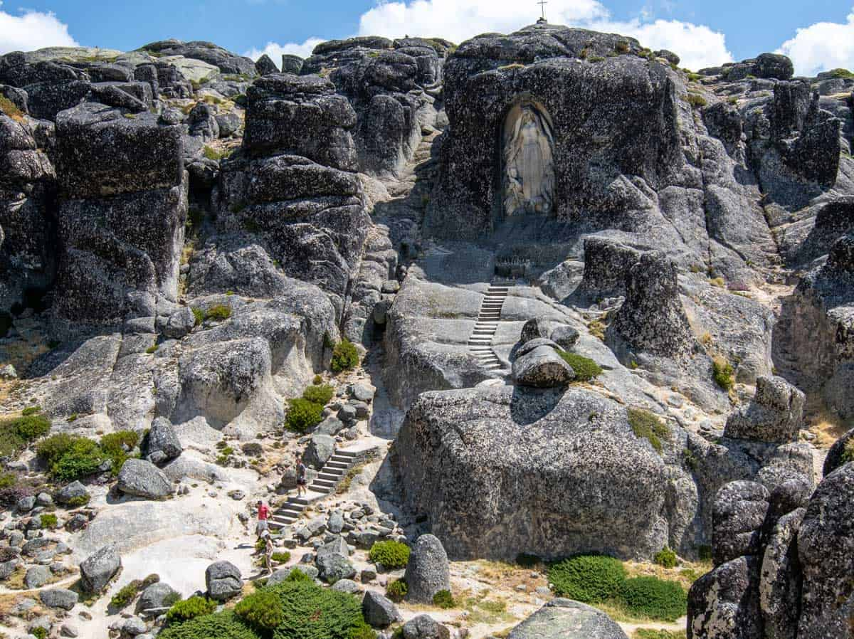 Giant rock carved statue of Mary in the rocks at the top of Serra da Estrela Portugal.