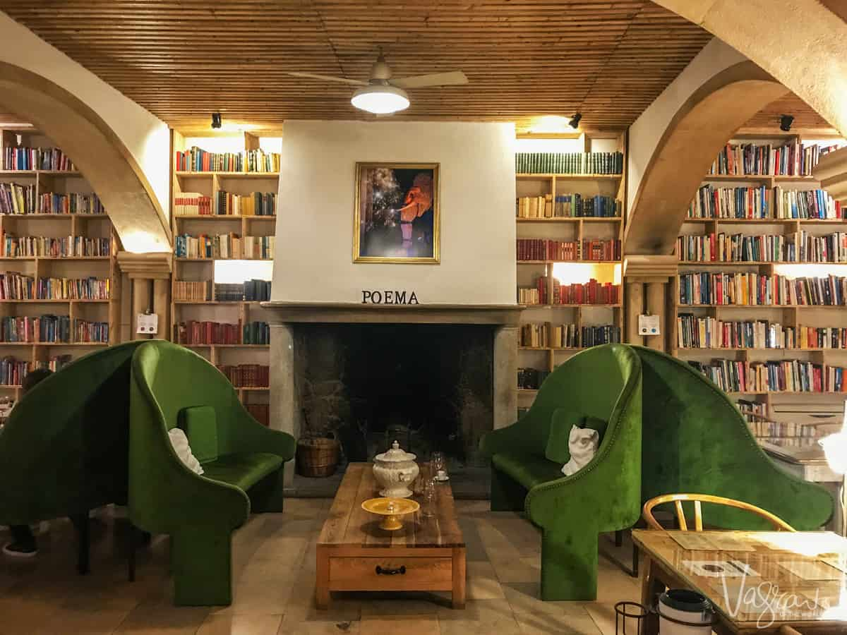 Big green velvet sofas in the library of the Literary Man Hotel in Obidos Portugal.