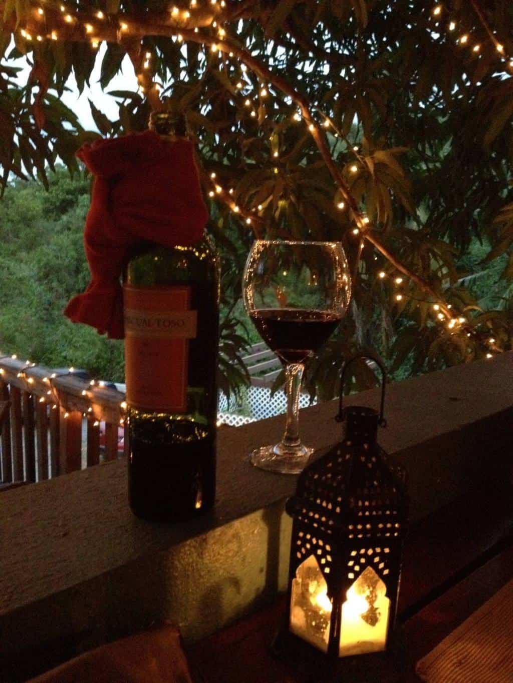 Bottle of wine on a candle lit table in a restaurant on Vieques Island.