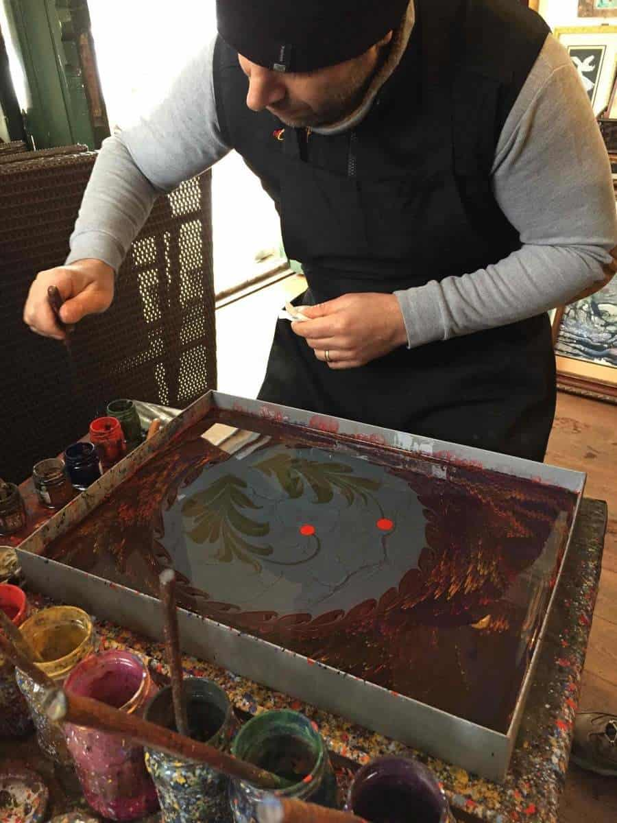 man doing ebru painting in Cafer Aga Madrasa Art College in Istanbul. looking for unique things to see and do in istanbul then pay this art college a visit.